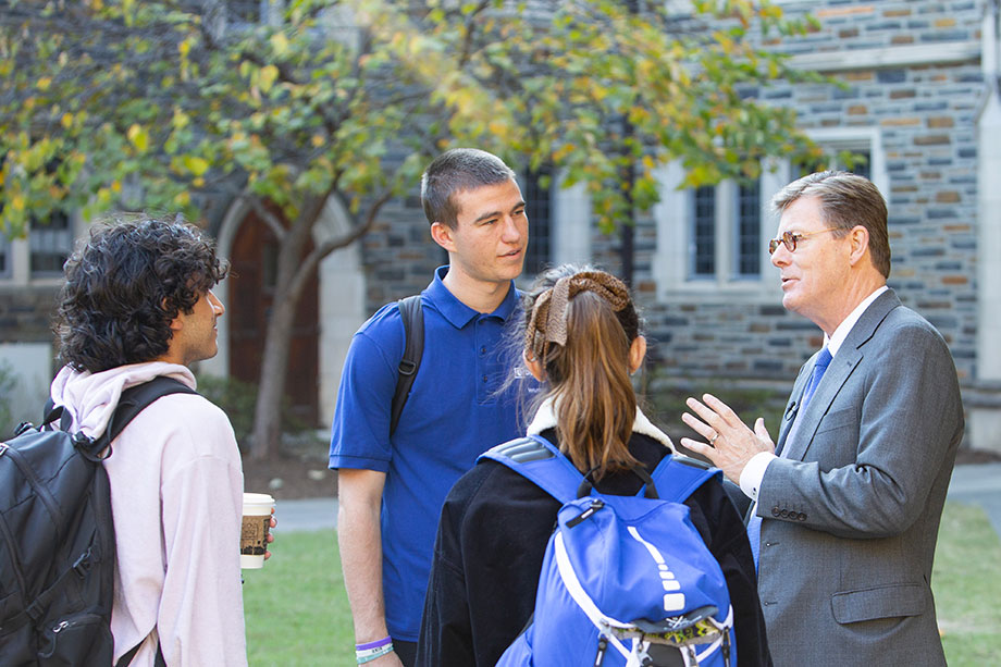 President Price talking with students in Few Quad